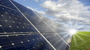 solar-panels-in-field-with-sun