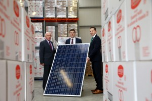 Major Investment Programme Gets Underway at Armagh Bakery / John Woods, (left) Managing Director and Patrick Woods, Sales & Marketing Director, Linwoods are pictured with Mel Courtney, General Manager, UK and Ireland, Kingspan Energy Ltd with a sample of one of the 200 rooftop solar panels which is being installed as part of a £2million development at the companies Armagh site.