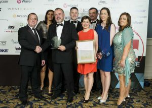 (L-R) Niall Dunne, country manager Ireland, Polycom presents Pat Larkin, CEO, Ward Solutions, and a number of the Ward Solutions team with the Managed Service Company of the Year award at the 2016 Tech Excellence Awards.